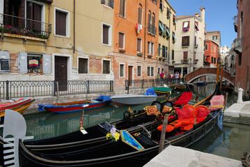 Plush gondolas moored at Rio dei Fraro at Campo dei Frari Venice