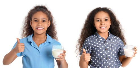 Little African-American girl with milk showing thumb-up on white background