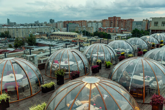 Igloo rooftop bar in the city. Romantic restaurant in the evening. Moscow, Russia, 09/13/2020.