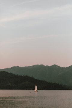 Sailboat on tranquil Whiskeytown Lake, Redding, California, USA