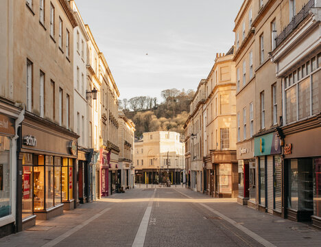 Buildings along empty main street, Bath, Somerset, UK