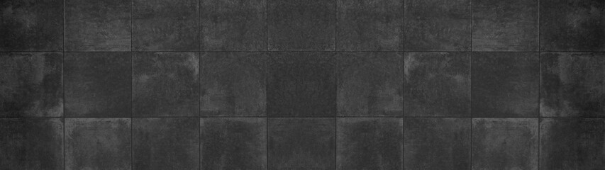 Seamless grunge dark black anthracite grey gray square mosaic concrete cement stone wall tiles pattern texture wide background banner panoramic panorama