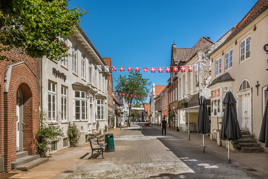 picturesque street with danish flags in Tonder, Denmark