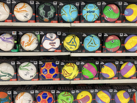 CIUDAD DE MEXICO, MEXICO - Sep 01, 2020: stacks of balls from basketball, soccer, and volleyballs, on the shelves of a supermarket voit brand