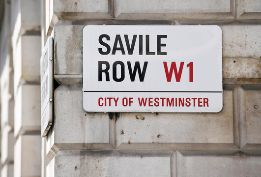 A street sign for Savile Row is seen as The Deck, the first shopfront tailors exclusively for women on the world famous street, renowned for its bespoke clothes making, opens in London