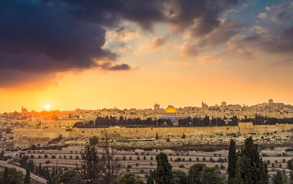 Dramatic sunset sky over Mount Zion and Old City Jerusalem; view of the Temple Mount with Dome of the Rock and Golden Gate, Kidron Valley in the foreground, and the skyline of West Jerusalem