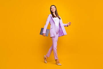 Full size profile photo of beautiful business ceo lady holding notebook hand going office building to work conference wear purple office costume isolated yellow color background