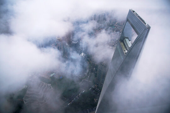 Skyscraper Shanghai World Financial Center is seen during heavy rain in Lujiazui financial district in Pudong