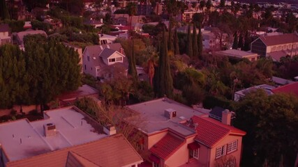 Fotobehang - Aerial view of city of Hollywood neighborhood revealing downtown Los Angeles skyline at sunset.
