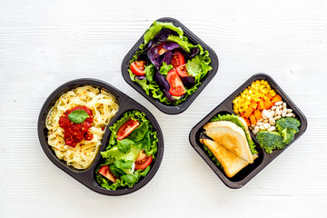 Healthy food in restaurant dish delivery. Top view, copy space