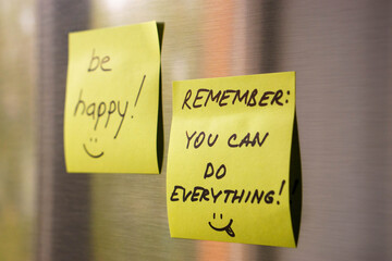 motivated reminders taped to fridge door