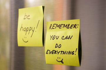 motivated reminders taped to fridge door