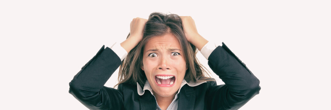 Funny crazy Asian business woman screaming in panic over stress at work. Mental health, anxiety, stressed out concept panoramic.