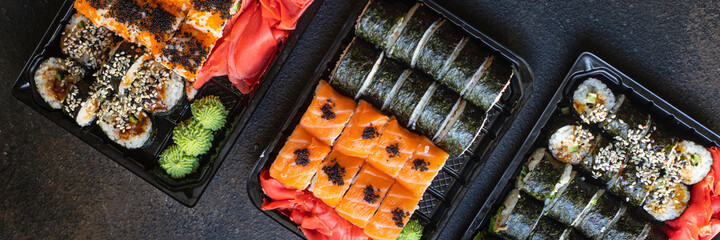 Photo sur Plexiglas Roe fresh sushi rolls salmon fish flying fish roe vegetables ginger wasabi rice and nori on the table serving size top view place copy space for text food background rustic