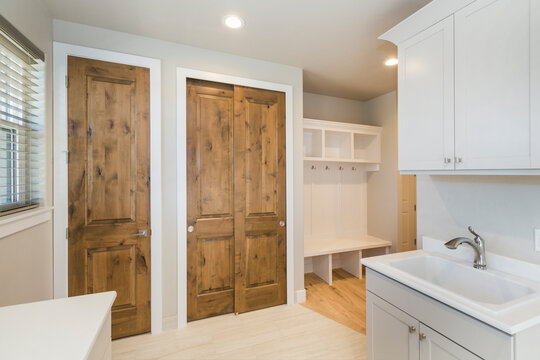 Farm House Laundry Room with closets and built in  Shelving