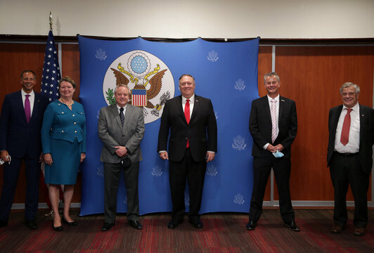 U.S. Secretary of State Mike Pompeo and others pose for a photograph during a meeting, in Paramaribo
