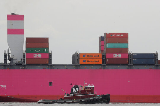 The ONE Hawk container ship is accompanied by a Tug Boar as it enter New York Harbor as seen from Brooklyn, New York