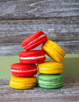 Vertical group of different colored and different flavored macrons