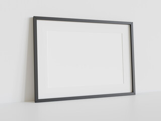 Black frame leaning on white floor in interior mockup. Template of a picture framed on a wall 3D rendering