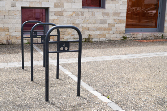 Metal bicycle parking lot in street city center for bike and motorbike