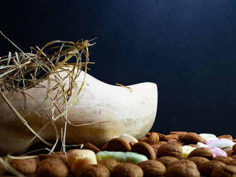 A wooden shoe with hay for the Dutch fest of Sinterklaas. Room for text.