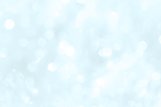 Bokeh light on blue background, sky with circle glitter light blue. Snow abstract soft glowing with vivid bright light and bokeh blur effect.