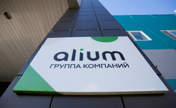 A board with the logo of Alium Group owned by Sistema financial corporation is on display near Moscow
