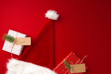 Santa Claus hat on red background top view