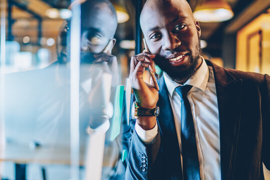 Portrait of dark skinned executive manager connecting to office wireless for making contact calling, African American professional lawyer communicating with customer discussing corporate meeting