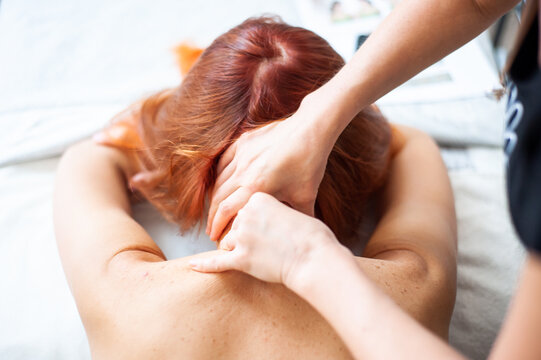 Therapeutic massage of the neck and back to stop the pain