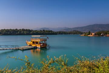 Green Lake in Green Canyon with boat. Manavgat, Antalya, Turkey. Long exposure shot, july 2020