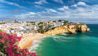 Wall Mural - Landscape with beach in Carvoeiro town with colorful houses in Algarve, Portugal