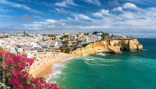 Wall mural Landscape with beach in Carvoeiro town with colorful houses in Algarve, Portugal