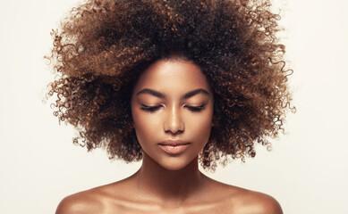Beautiful black woman . Beauty portrait of african american woman with clean healthy skin on beige...