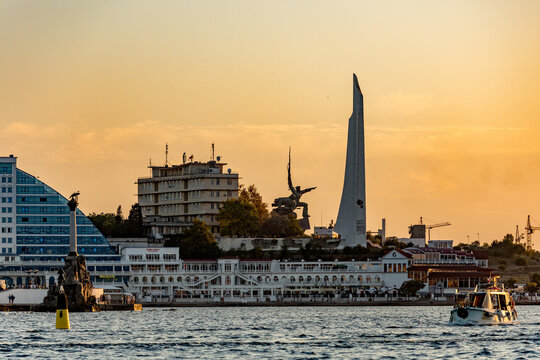 Russia, Crimea, Sevastopol - August 15, 2018: a monument to the feat of the defenders of Sevastopol during the second world war the Sailor and soldier on the hill of the Cape Crystal on sunset.