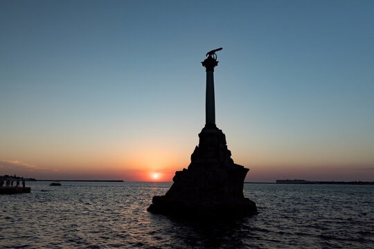 Monument to the scuttled Russian ships in Sevastopol at sunset. Crimea. Russia