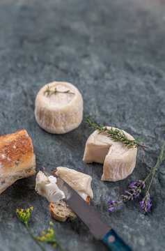 Goat cheese crottin de chavignol. Speciality, tasting wich knife and bread
