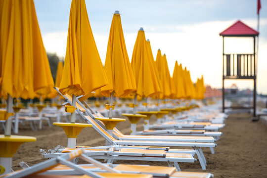 Empty beach and sun beds due to coronavirus pandemic, covid-19 disease and social distancing policies hit hard tourism and travel businesses.