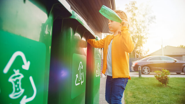 Young Girl is Throwing Away an Empty Plastic Bottle into a Trash Bin. She Uses Correct Garbge Bin Because This Family is Sorting Waste and Helping to Save the Environment.