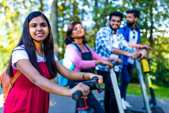 modern indian friends ride on segway in park in India