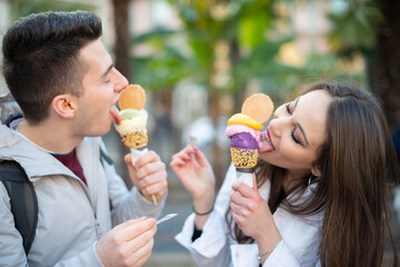 Happy couple eating an ice cream
