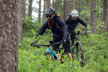 Cycling outdoor adventure in alpine forest at the lago di braies, Dolomites, Italy