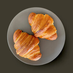 two fresh croissants on grey plate