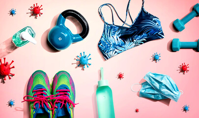 Fitness and coronavirus theme with workout set - flat lay