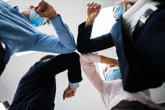 Employee Doing Elbow Bump To Avoid Flu