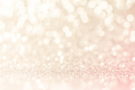 Pink gold, beige,pink,light brown abstract light background,Golden shining lights,elegance,smooth backdrop or artwork design for new year,Christmas sparkling glittering Women,Valentines day..