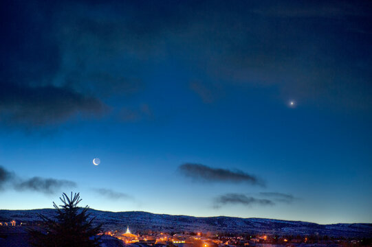 Quarter moon & Venus over Laramie Range at dawn;  Laramie, Wyoming