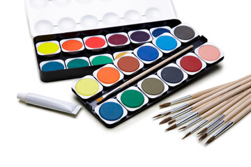 Watercolor paints box with paint brush on white background