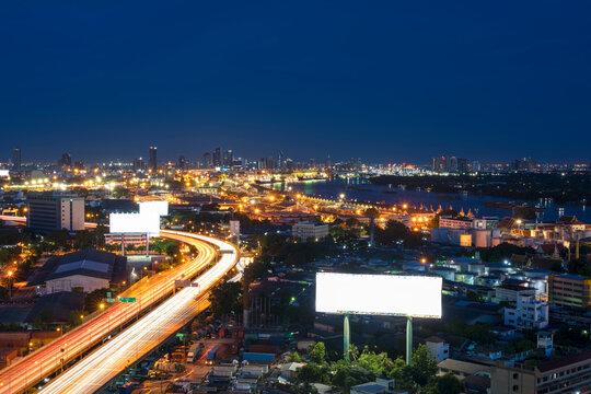 Cityscape of Bangkok viewing Chao Phraya River and expressway at night