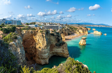 Wall Mural - Landscape with cliff, resort and Dona Ana beach at Algarve coast in Portugal